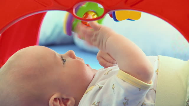 cu baby boy (2-5 months) playing with toy / vrhnika, slovenia - vrhnika stock videos & royalty-free footage