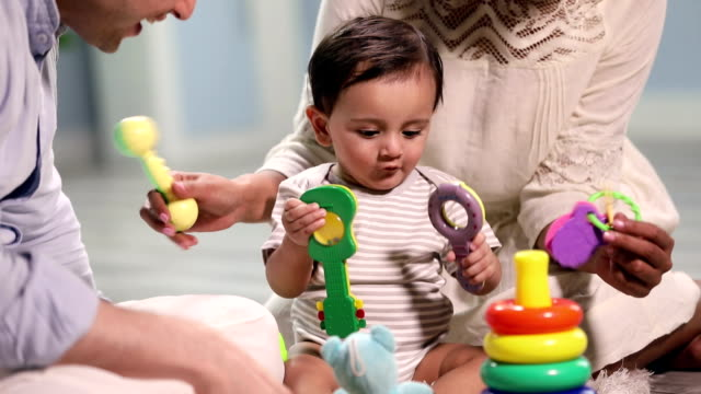 baby boy playing with toys, delhi, india - strampelanzug stock-videos und b-roll-filmmaterial