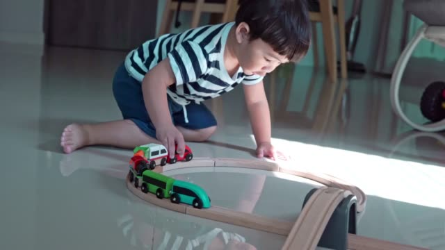 baby boy playing wooden train at home - railroad car stock videos & royalty-free footage