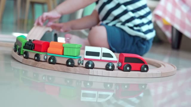 baby boy playing wooden train at home - tramway stock videos & royalty-free footage