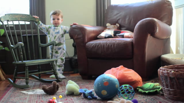 baby boy pushing over rocking chair - babygro stock videos & royalty-free footage