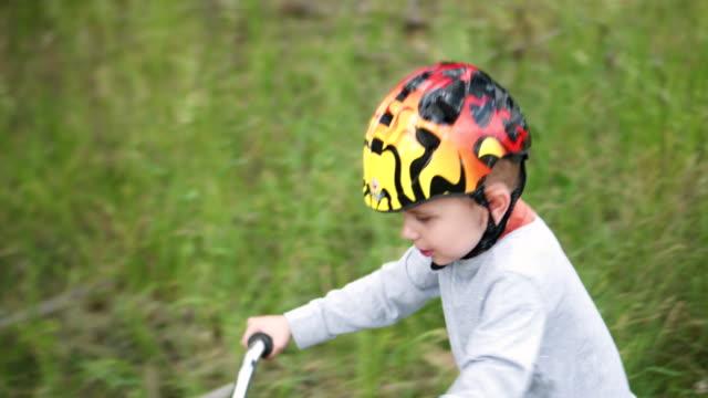 Baby boy rides a bike