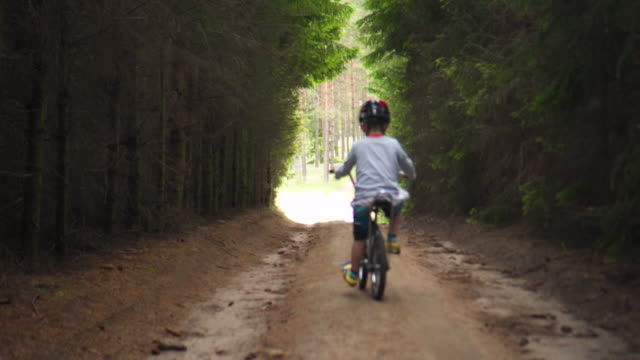 baby boy rides a bike - baby boys stock videos & royalty-free footage