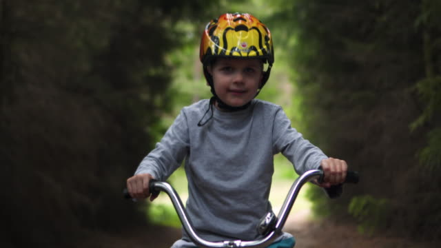 baby boy rides a bike - baby boys stock videos and b-roll footage