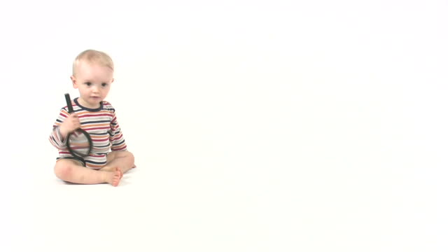 baby boy searching - plain background stock videos & royalty-free footage