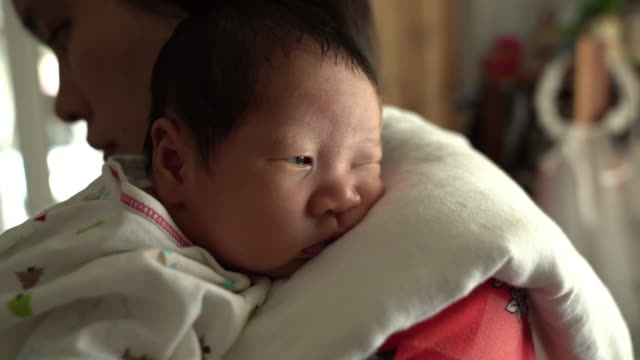 baby boy sleep with mother - new stock videos & royalty-free footage