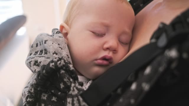 baby boy sleeping in baby carrier - baby carrier stock videos & royalty-free footage