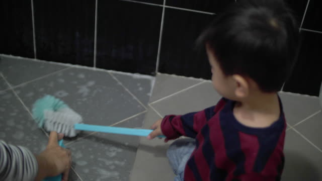 baby boy support mother for cleaning restroom, 4k - utility room stock videos and b-roll footage