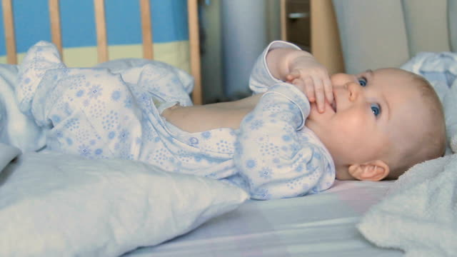 Baby boy waking up, close-up