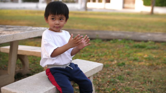 baby boy walking and playing outdoors - baby boys stock videos & royalty-free footage
