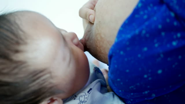 baby breastfeeding - breastfeeding stock videos & royalty-free footage