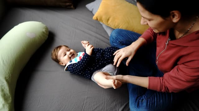 baby care - changing nappy stock videos & royalty-free footage