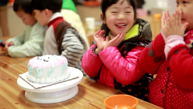 baby children enjoy their birthday party - preschool student stock videos and b-roll footage