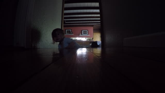 a baby climbing up the steps of a house indoors. - one baby girl only stock videos & royalty-free footage