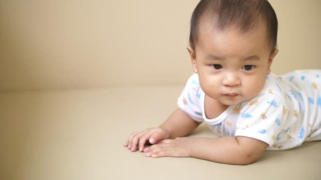 baby crawling and playing on the floor - lying down stock videos & royalty-free footage