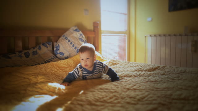 baby crawling in bed - double bed stock videos & royalty-free footage