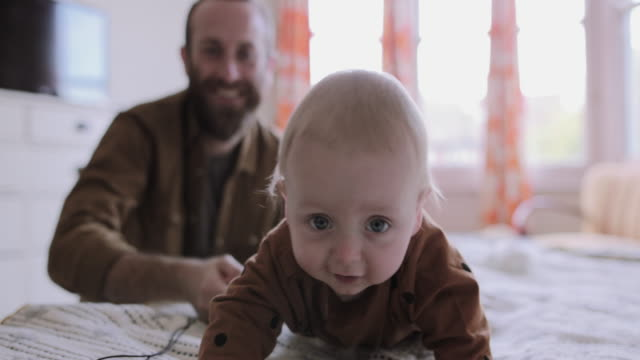 baby crawling on bed towards camera - crawling stock videos & royalty-free footage