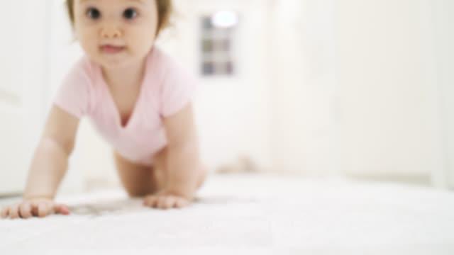 a baby crawling on corridor - babygro stock videos & royalty-free footage