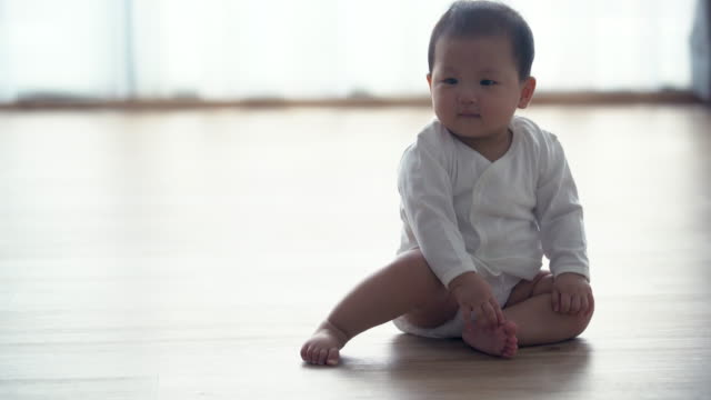 ms baby crawling on the floor and smiling - baby girls stock videos & royalty-free footage