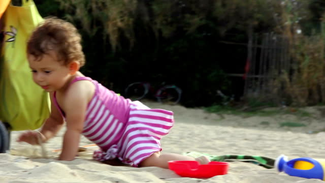 baby crawls on the beach - babies only stock videos & royalty-free footage