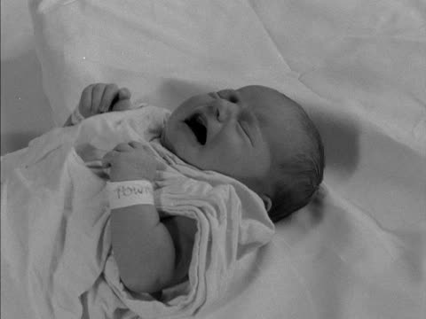 a baby cries while laying on a blanket - bedclothes stock videos & royalty-free footage