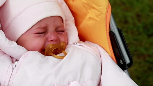 baby crying in the pram - pacifier stock videos and b-roll footage