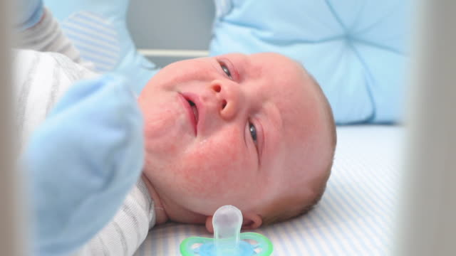 baby crying laying in his crib slow motion - shouting stock videos & royalty-free footage