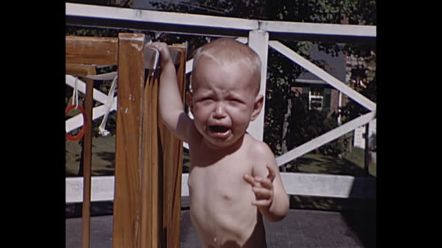 1940 - Baby crying on front porch