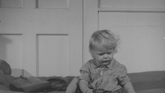 1947 MS Baby crying over dropped bottle / United Kingdom