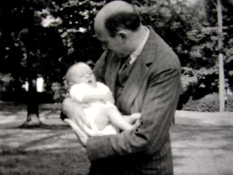 1931 baby, dad, and crib in back yard - 1931 stock videos & royalty-free footage
