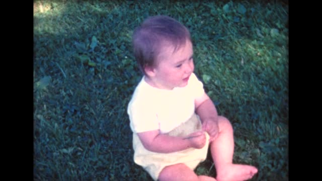 1961 baby discovers lawn grass - home movie stock videos & royalty-free footage