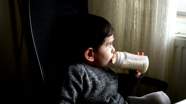 baby drinking bottle - powdered milk stock videos & royalty-free footage