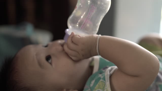 baby drinking milk from the bottle - powdered milk stock videos & royalty-free footage