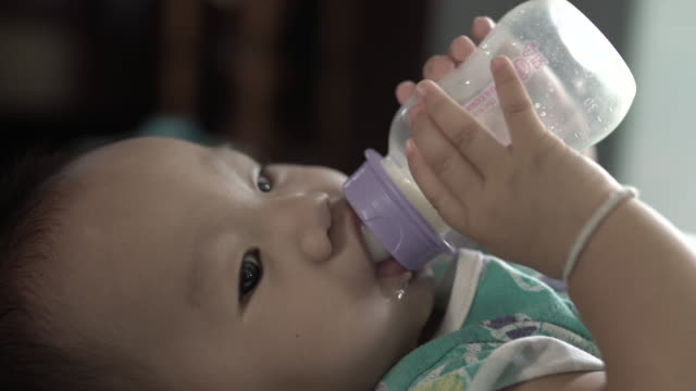 Baby drinking milk from the bottle