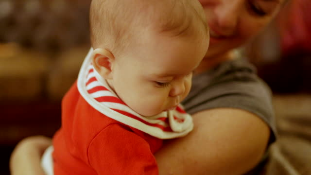 baby drooling on mother at christmas - carrying stock videos & royalty-free footage
