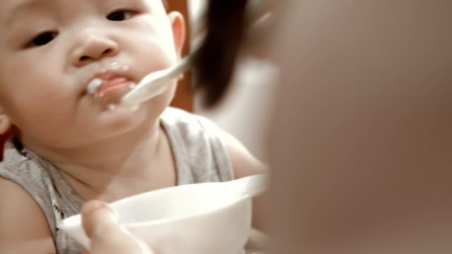 baby eating baby food - wishing well stock videos & royalty-free footage