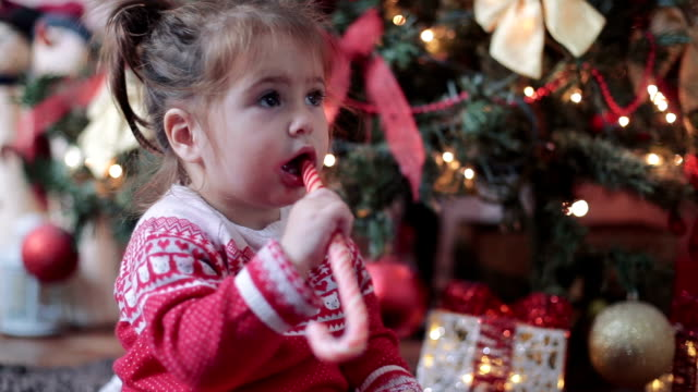 baby eating candy on christmas - confectionery stock videos & royalty-free footage