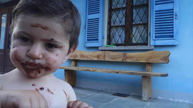 stockvideo's en b-roll-footage met baby eating chocolate ice cream - one baby boy only