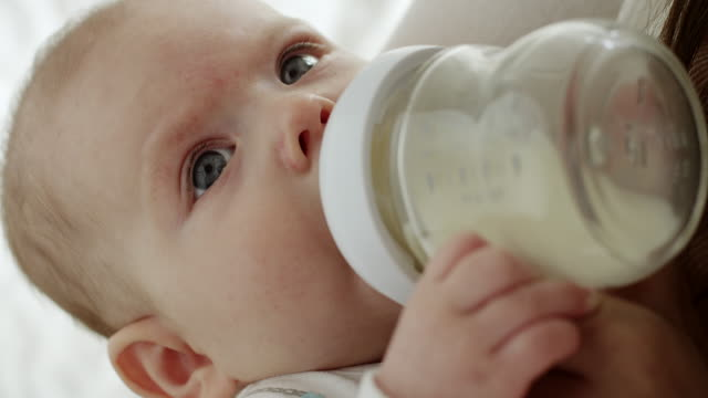 baby eating from baby bottle - baby bottle stock videos & royalty-free footage