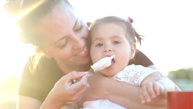 baby eating ice cream on a stick for a first time - feeding stock videos & royalty-free footage