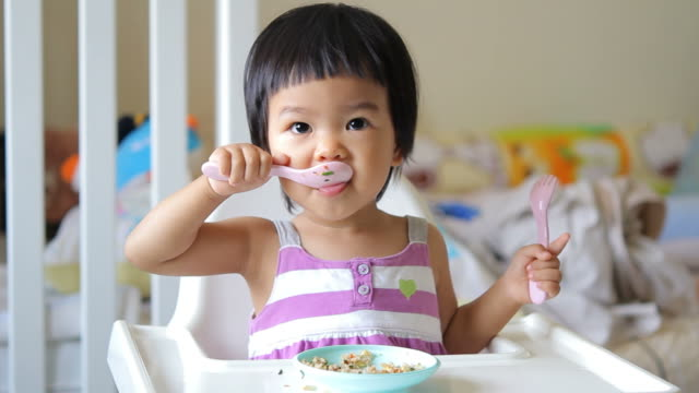 hd : baby eating - eating utensil stock videos and b-roll footage