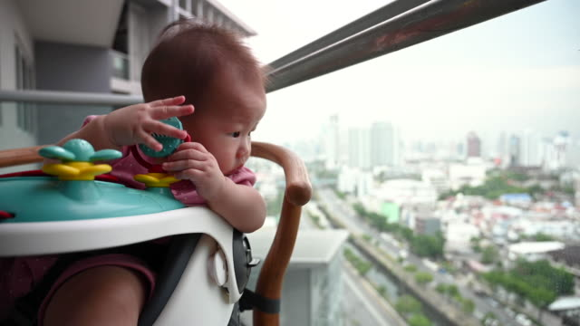 baby enjoying city view from her highchair - eating utensil stock videos & royalty-free footage