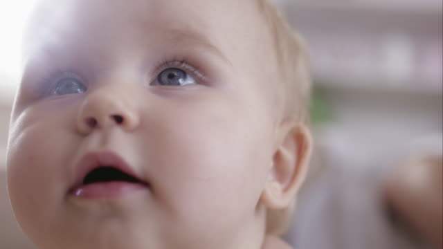 baby face - close up - blue eyes stock videos and b-roll footage