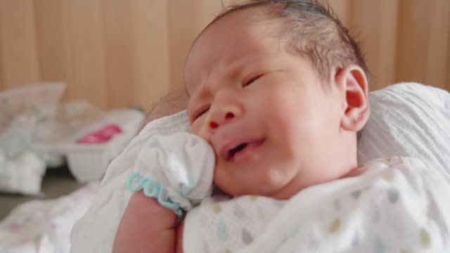 baby feeling; crying newborn baby boy face close up of eurasian ethnicity. - eurasian ethnicity stock videos and b-roll footage