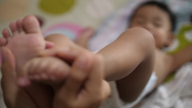 baby feet in mother hands - toe stock videos & royalty-free footage