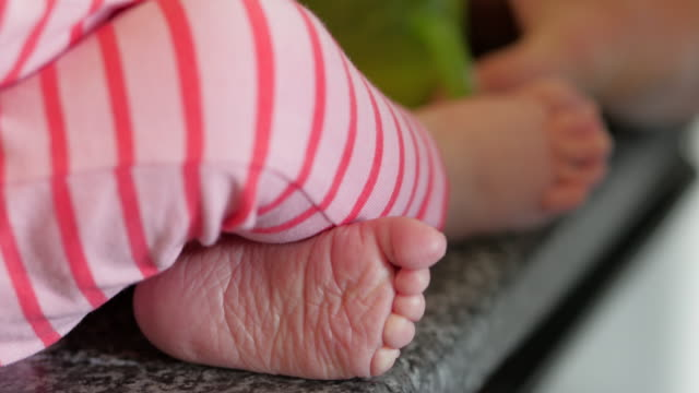 baby feet - girl cross legged stock videos & royalty-free footage