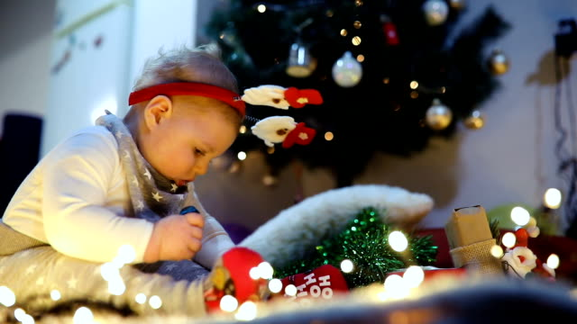 baby first christmas.  new year's holidays. - santa hat stock videos and b-roll footage