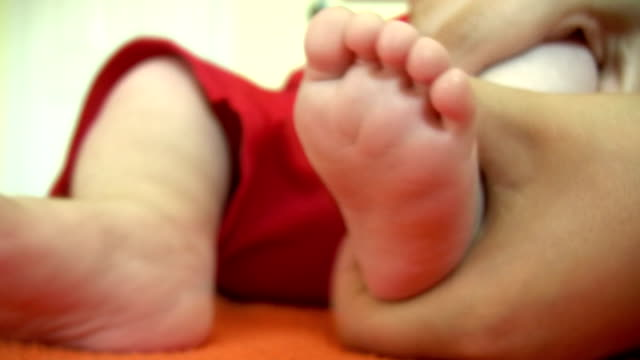 baby foot massage - burping stock videos & royalty-free footage