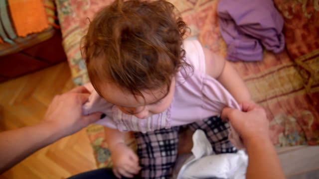 baby getting dressed. pov - females stock videos & royalty-free footage