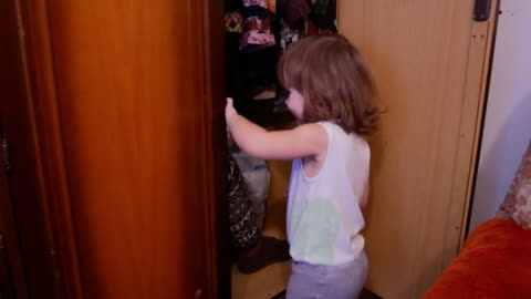 baby girl and mom playing at home hide and seek - hiding stock videos & royalty-free footage